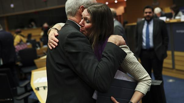 Scottish European Parliament member Aileen McLeod, right, hugs British European Parliament member Richard Corbett.