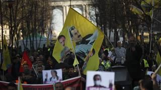 Pro-Kurdish people wave flags with the face of jailed PKK leader, Abdullah Ocalan, during a protest demanding his freedom in Brussels in February 2019.