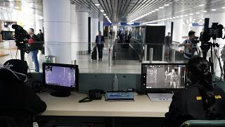 Health officials watch thermographic monitors at a quarantine inspection area at Kuala Lumpur International Airport.
