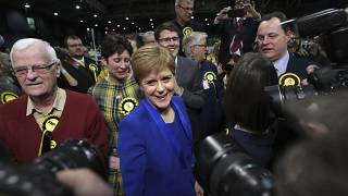 Scottish First Minister Nicola Sturgeon smiles as she arrives at the SEC Centre in Glasgow for the declaration in her constituency in the 2019 general election, Friday Dec. 13