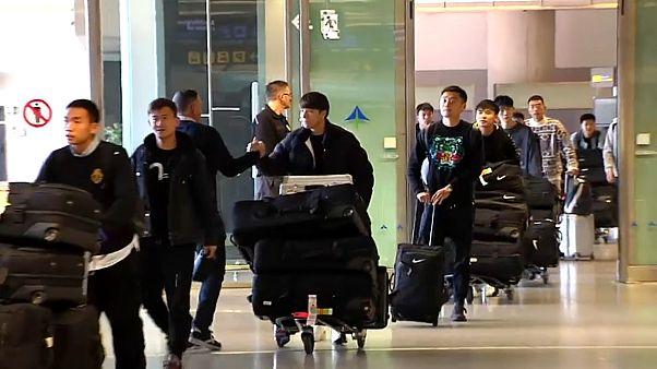 El equipo de fútbol de Wuhan a su llegada a Málaga