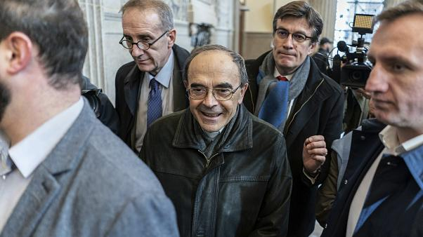 FILE: French Cardinal Philippe Barbarin, center, arrives at the Lyon courtroom for his appeal trial Thursday, Nov.28, 2019 in Lyon, central France.