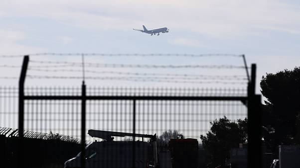 The plane carrying European passengers escaping Wuhan prepares to land at the military air base in Istres, southern France, Friday Jan.31, 2020.