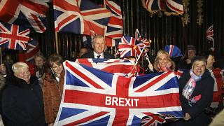 Brexit supporters celebrate during a rally outside Stormont in Belfast, Northern Ireland as Britain left the European Union on Friday, Jan. 31, 2020.