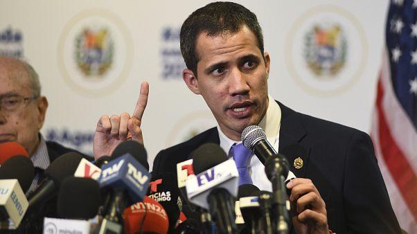 Venezuela's interim President Juan Guaidó speaks to the media after a rally in Miami, Saturday Feb. 1, 2020. (AP Photo/Gaston De Cardenas)