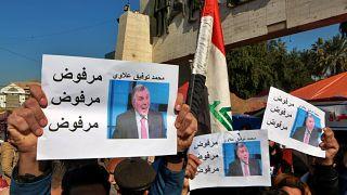 متظاهرون عراقيون يرفضون رئيس الوزراء الجديد محمد توفيق علاوي