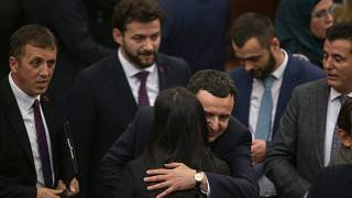 Albin Kurti, the newly elected prime minister of Kosovo is congratulated by lawmakers after the new government was elected in the capital Pristina, Monday, Feb. 3, 2020.