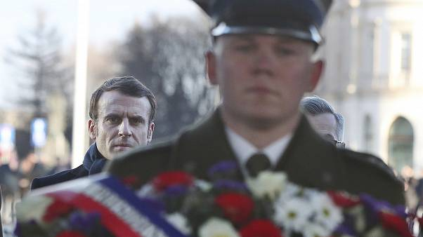 French President Emmanuel Macron takes part in a wreath laying ceremony at the tomb of the Unknown Soldier in Warsaw, Poland, Monday, Feb. 3, 2020.