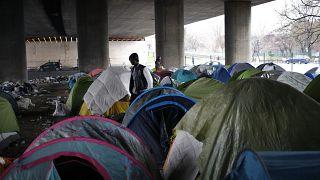 Migrants in a makeshift camp alongside the Porte de la Villette bridge in Paris, in January 2019.