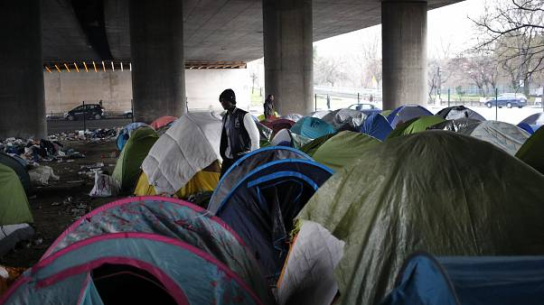Migrants in a makeshift camp alongside the Porte de la Villette bridge in Paris, in January 2019.