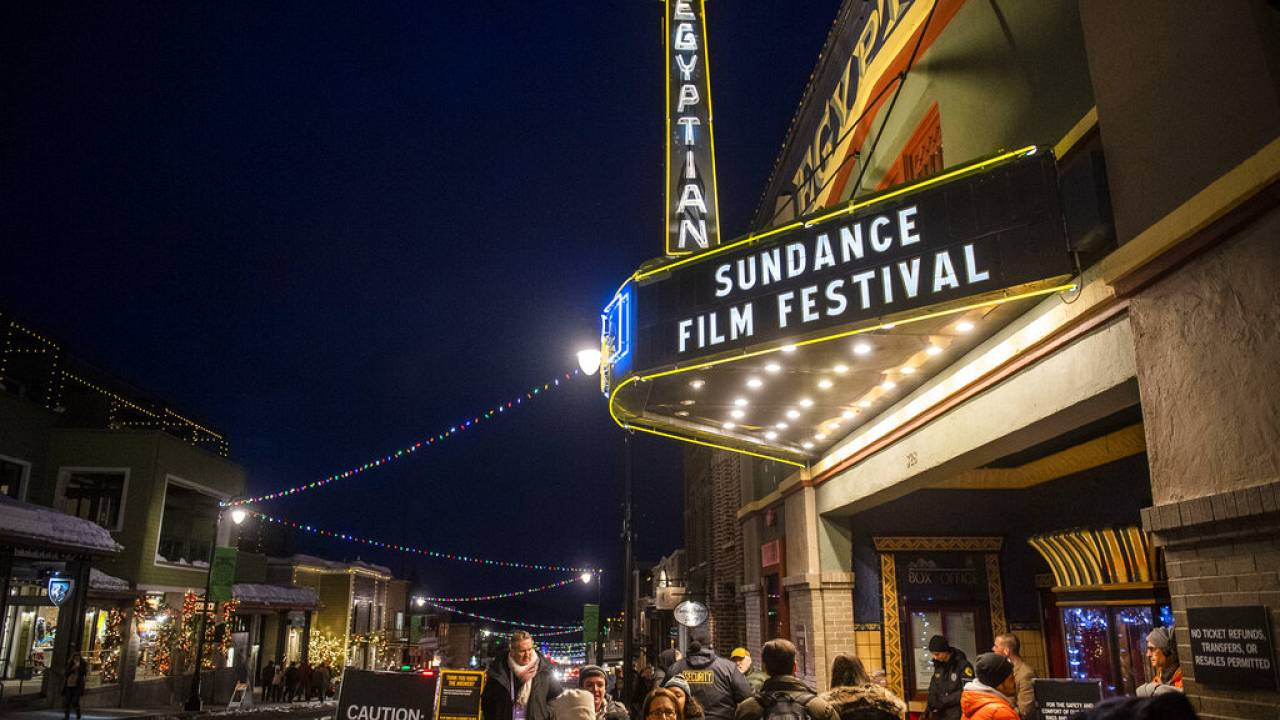 People walk under the marquee of the Egyptian Theatre on the sixth day of the 2020 Sundance Film Festival.
