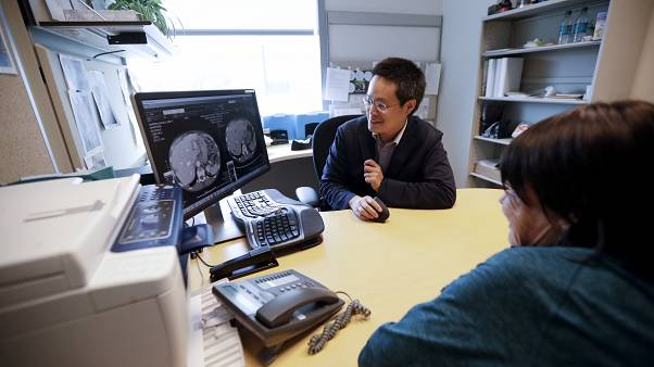 ln this  Aug. 15, 2017 photo, a patient looks at images with her doctor Shumei Kato, left, at the University of California San Diego in San Diego.