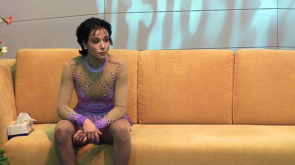 France's Sarah Abitbol in January 24, 2001, reacts after taking the bronze bronze medal in the Pair's free program of the European Figure Skating Championships in Bratislava