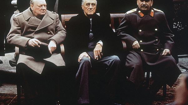 Britain's Winston Churchill (L), the US' Franklin Roosevelt (C) and Soviet leader Joseph Stalin (R) on the patio of Livadia Palace, Yalta, Crimea in February 1945.