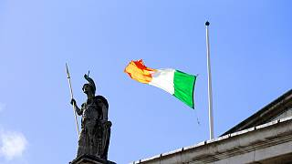 The Irish flag flouts the wind as it flies at half staff over the General Post Office on O'Connell street, Dublin, Ireland, Sunday, March, 27, 2016.