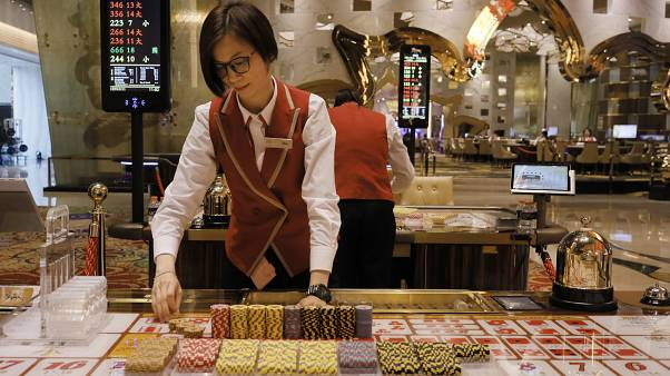 FILE PHOTO : A croupier works at a gaming table at MGM Cotal Rescort in Macau Tuesday, Feb.13, 2018.
