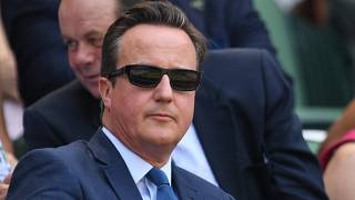Former British Prime Minister David Cameron arrives at The All England Lawn Tennis Club in Wimbledon, southwest London, on July 6, 2018