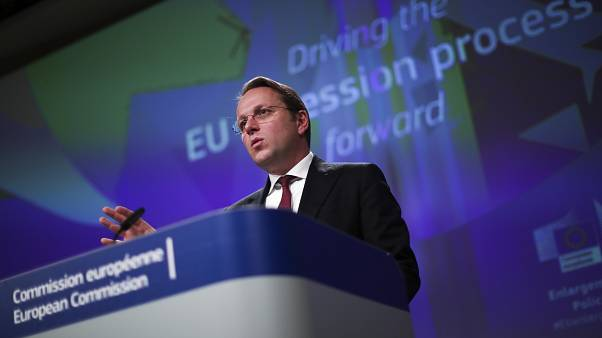 European Commissioner for Neighbourhood and Enlargement Oliver Varhelyi talks to journalists during a news conference at the European Commission headquarters in Brussels