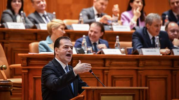 Romanian Prime Minister Ludovic Orban delivers his speech during a no-confidence vote at the Romanian Parliament in Bucharest on February 5, 2020.