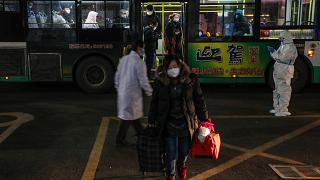 This photo taken on February 5, 2020 shows patients displaying mild symptoms of the novel coronavirus as they arrive at an exhibition centre converted into a hospital in Wuhan