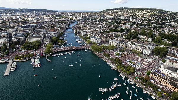"""Aerial view of the annual technoparade """"Street Parade"""" in the city center of Zurich, Switzerland, on Saturday, August 10, 2019. (KEYSTONE/Alexandra Wey)"""