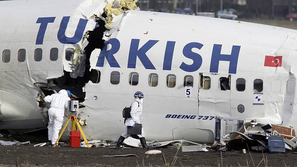 Crash investigators examine the wreckage of the Turkish airlines plane at Amsterdam's Schiphol Airport, Thursday, Feb. 26, 2009.