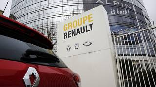 FILE PHOTO: Thursday, Jan. 24, 2019  -  A Renault car is parked outside the French carmaker headquarters in Boulogne-Billancourt, outside Paris, France.