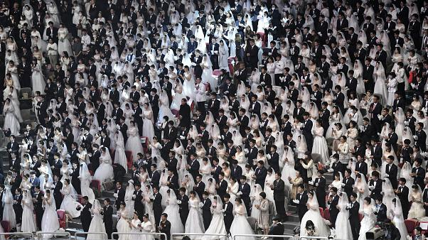 Couples attend a mass wedding ceremony organised by the Unification Church at Cheongshim Peace World Center in Gapyeong on February 7, 2020