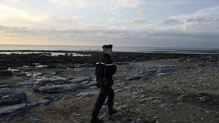 French gendarme patrols the beach in Ambleteuse near Calais, northern France.