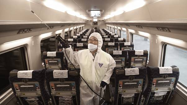 (January 24, 2020) , A train officer sprays disinfectant as a precaution against coronavirus contamination at Suseo Station in Seoul, South Korea.