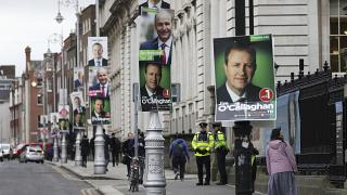 Election posters are displayed on lampposts outside the Irish Prime Minister offices in Dublin, Ireland, Friday, Feb. 7, 2020.