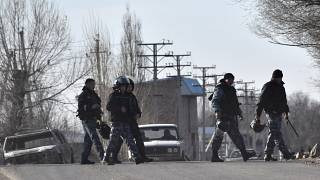 (February 8, 2020) Riot police guard the streets in the village of Masanchi, Kazakhstan.