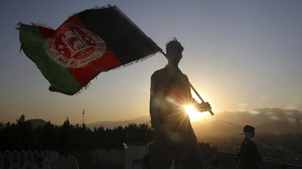 (August 19, 2019) A man waves an Afghan flag during Independence Day celebrations in Kabul, Afghanistan