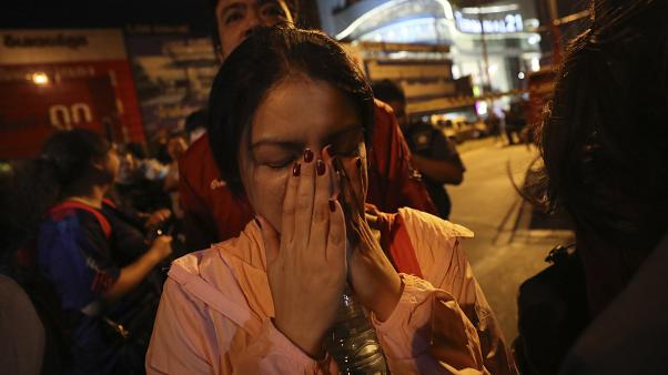 A woman who was able to get out of Terminal 21 Korat mall gestures with her hands on her face in Nakhon Ratchasima, Thailand on Sunday, Feb. 9, 2020