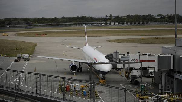 A British Airways plane sits parked at Heathrow Airport in London, Monday, Sept. 9, 2019.