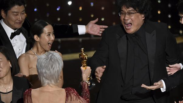 "Bong Joon Ho, right, reacts as he is presented with the award for best picture for ""Parasite"" from presenter Jane Fonda at the Oscars on Sunday, Feb. 9, 2020."