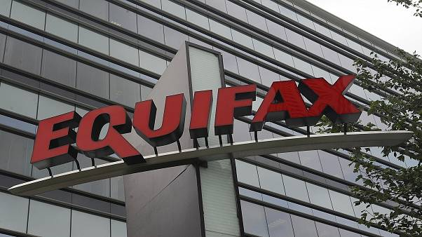FILE- This July 21, 2012, file photo shows signage at the corporate headquarters of Equifax Inc. in Atlanta.