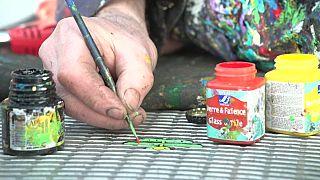 بن ويلسون يرسم في أحد شوارع لندن. 2020/01/28