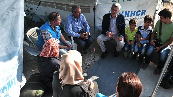 UN high commissioner for refugees Filippo Grandi speaks with Syrian refugees