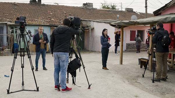 FILE PHOTO: Television reporters stand outside the house of Severin Krassimirov, suspect in the killing of journalist Viktoria Marinova