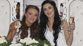 Robyn Peoples, left, and Sharni Edwards pose together after becoming the first same sex couple to marry in Northern Ireland, in Carrickfergus, Tuesday Feb. 11, 2020