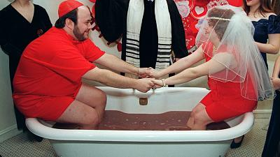 Cheryl Minikes and Matthew Mandell, both 22, from Brooklyn, take the ultimate St. Valentine's Day plunge by getting married in a bathtub full of hot chocolate.