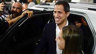 Opposition leader Juan Guaido arrives at a rally at Bolivar Plaza
