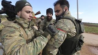 Turkish backed fighter prepare to go to the frontline in the Syrian province of Idlib, Monday, Feb. 10, 2020.