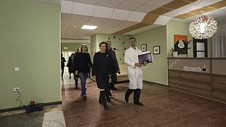 A group of local officials walk inside the sanatorium in Bogandinsky in the Tyumen region, about 2150 kilometers (1344 miles) east of Moscow, western Siberia, Russia, Tuesday,