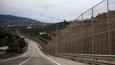 More than 200 migrants climb fence to enter Spanish enclave of Melilla