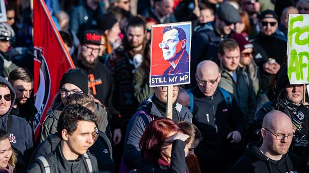 """Demonstrators hold a poster showing former Thuringian state premier Bodo Ramelow and reading """"Still my MP"""" at a protest themed """"Not with us! No pacts with fascists"""""""