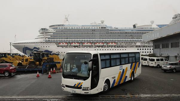 A bus believed to be carrying passengers from the quarantined Diamond Princess