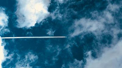 These cloud trails are created by ice crystals that form around carbon particles emitted by the engines.