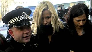 Love Island TV presenter Caroline Flack, centre, escorted by police, as she arrives at Highbury Magistrates' Court in London, Monday, Dec. 23, 2019.
